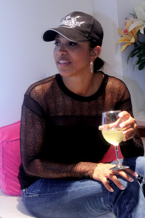 Tisha enjoys a glass of wine with her pedi
