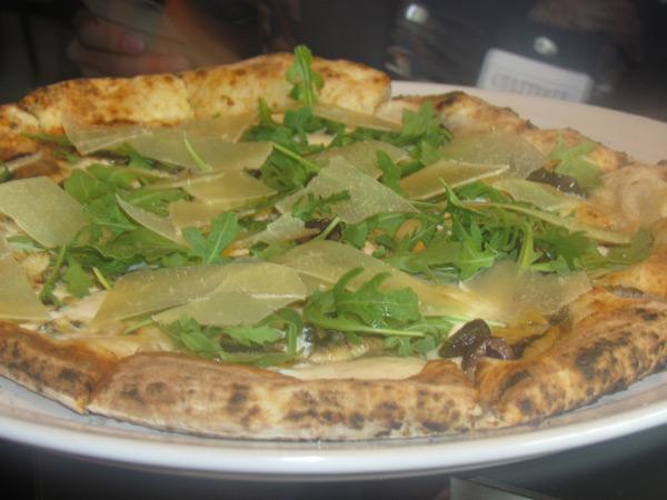 STG Trattoria's anchovy, capers, taggiasca olives, arugula, and taleggio pizza