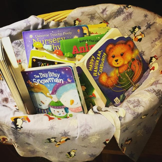 A new selection of board books are available in the children's book section - this lovely basket is kept low to the ground so our younger patrons can select their own favorites. #ohrstromlibrary #boardbooks #newbooks #childrensbooks #holidaybooks #bookdisplay #iamsps #littlereaders