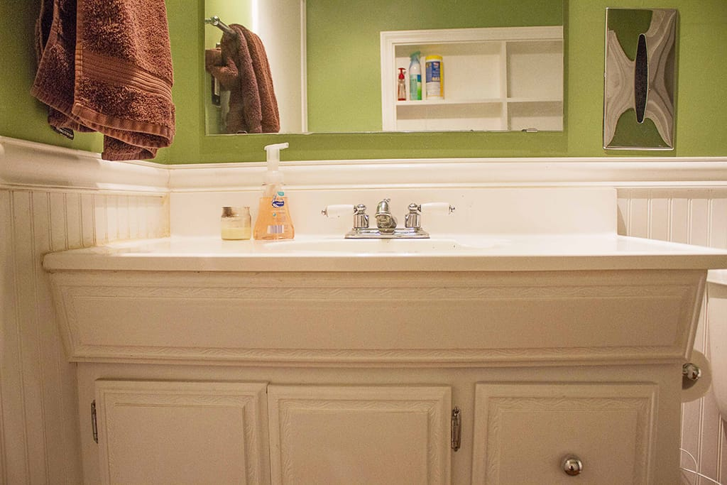 Join Audrey of Oh So Lovely Blog on a quick and super affordable in process tour of her half bathroom update featuring Cabinets Quick!