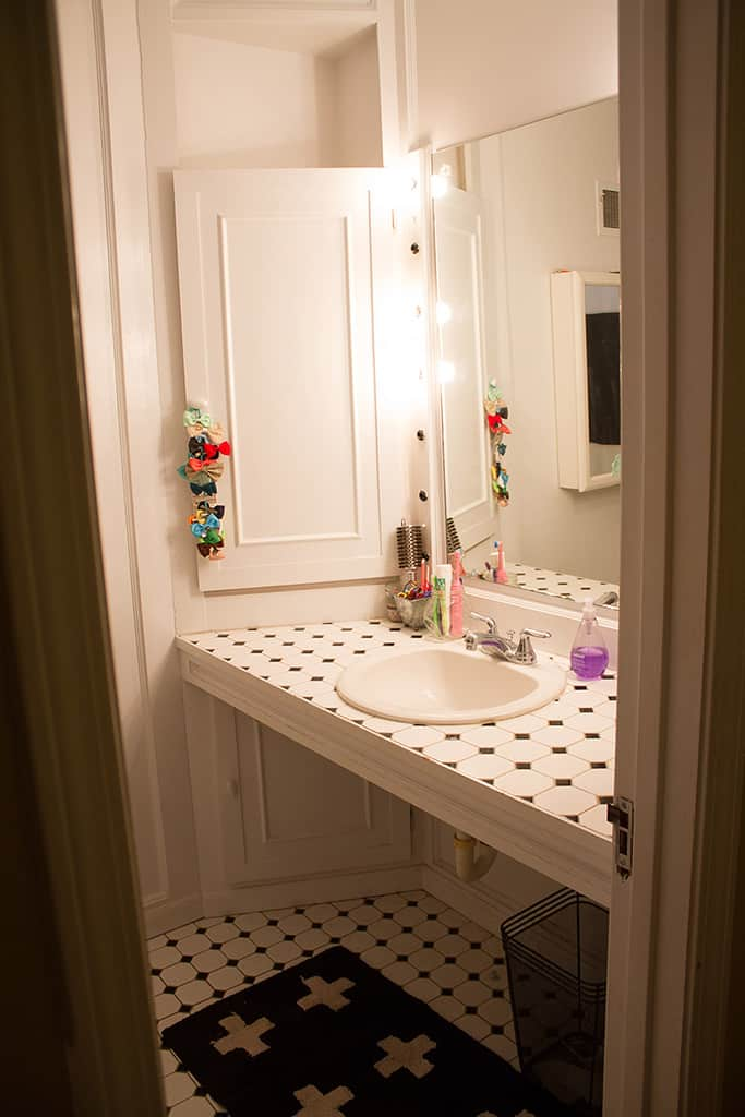 Audrey Kuether of Oh So Lovely Blog shares a guest bathroom remodel featuring a DIY custom vanity. See all the before and after photos and products used.
