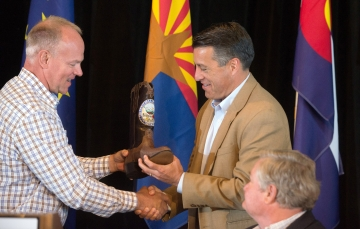 Incoming Chairman Matt Mead of Wyoming presents Gov. Sandoval a gift of hand-made boots in appreciation for his work during the past year as Chaiman.