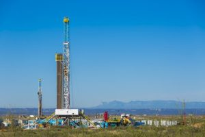 WPX Energy, Delaware basin. Three drilling rigs on multi-well pads. L to R: Orion Drilling, Pegasus on the CBR 22-10H, Aries on the CBR 22-14H.