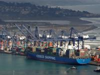FILE PHOTO: A China Ocean Shipping Company (COSCO) container ship is seen at San Antonio port in Chile August 6, 2019. REUTERS/Rodrigo Garrido/File Photo