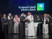 Amin Nasser, chief executive officer of Saudi Aramco, center left, and Yasir Al-Rumayyan, chairman of Saudi Aramco, center right, during the Aramco IPO event in Riyadh, on Dec. 11.Source: Saudi Arabian Oil Co.