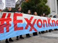 Climate activists protest on the first day of the Exxon Mobil trial outside the New York State Supreme Court building on October 22, 2019 in New York City. Angela Weiss | AFP | Getty Images