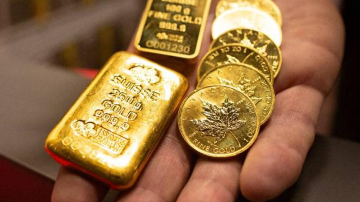 Onza de oro y crédito suizo (Imagen: Orobel.biz)