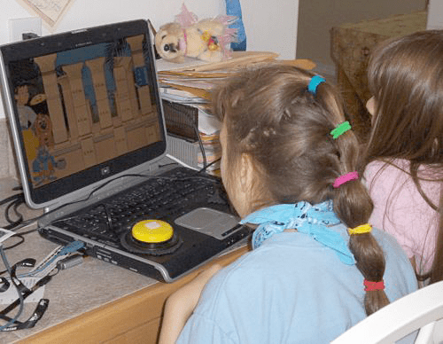 Pre-K student using a Jelly Bean switch with computer