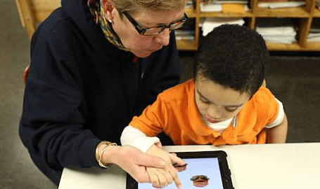 PreK child with iPad