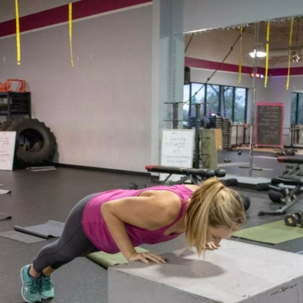 Brittany doing a push up at Kaia FIT Roseville