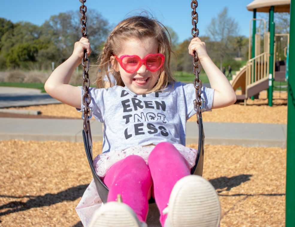 Child on swing laughing