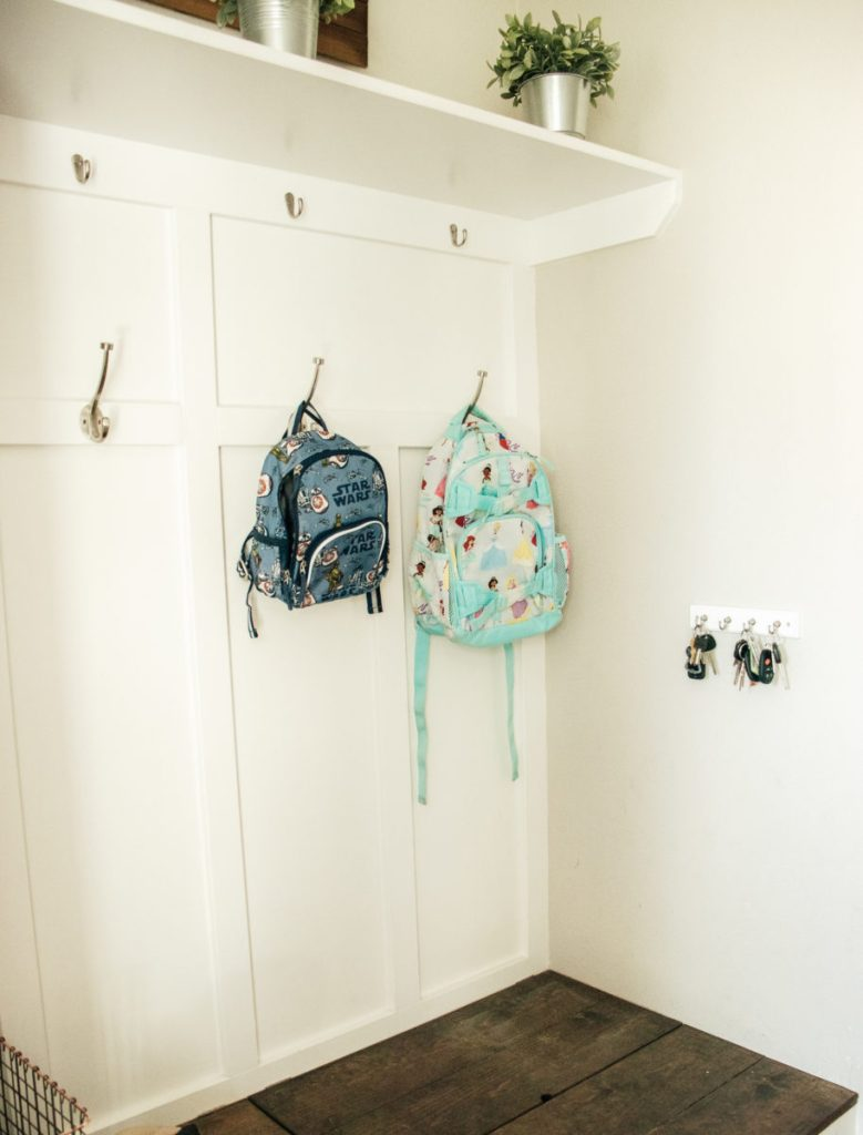 Pottery Barn backpacks hanging on a hook