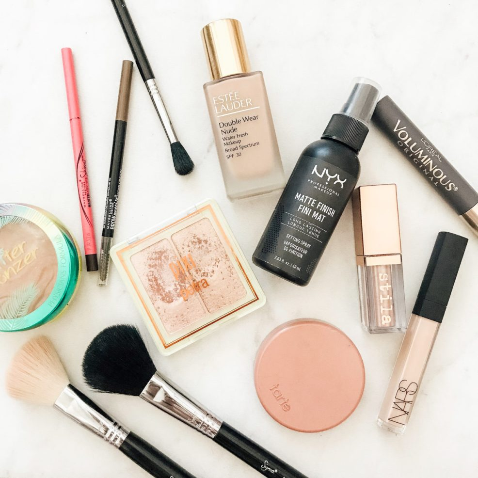 flat lay picture showing high and low end makeup bag favorites