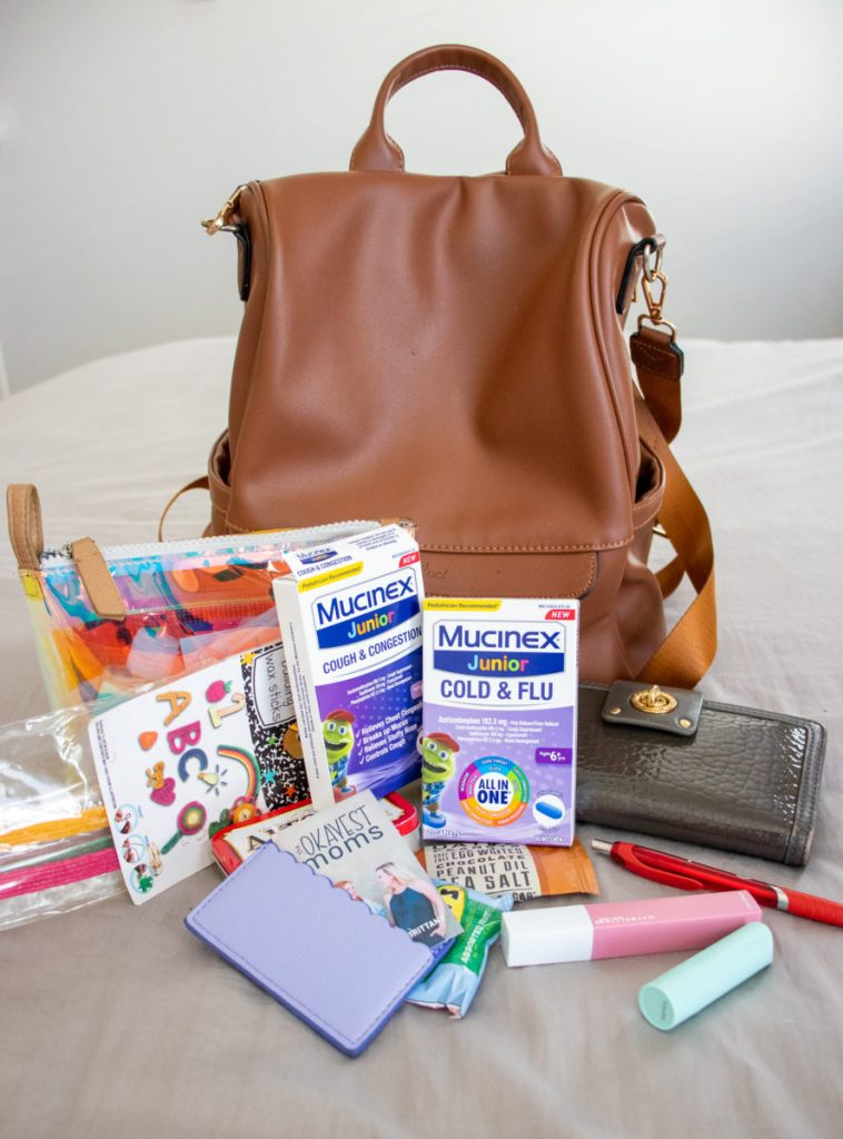 Contents of all the Mom Bag Essentials including Mucinex Junior Cough & Congestion- Okayest Moms
