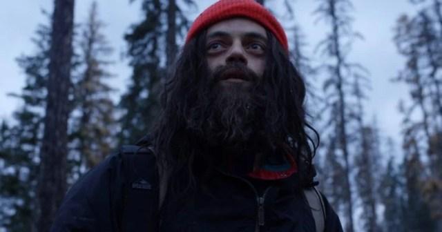 Película Buster's mal heart con Rami Malek; hombre con barba y cabello largo descuidados, con gorro rojo