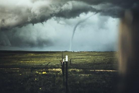 Tornado on the far side of plain