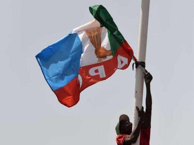 A suppoter tries to display All Progressives Congress (APC) party flag on a pole, during incumbent President Mohammadu Buhari's presidential campaign rally at the Sanni Abacha Stadium in Kano, on January 31, 2019. - Buhari has flag off campaign in Kano, the commercial nerve centre of northern Nigeria to seek re-election at the forthcoming February polls. (Photo by PIUS UTOMI EKPEI / AFP) (Photo credit should read PIUS UTOMI EKPEI/AFP via Getty Images)