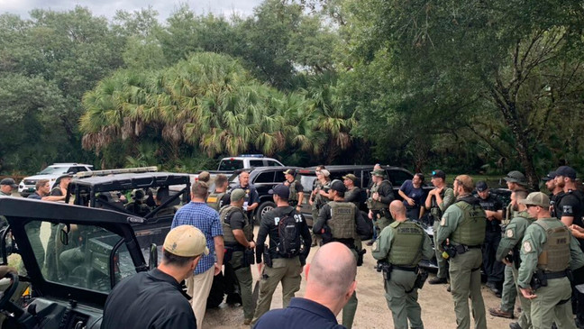 This photo provided by North Port Police Department, law enforcement officials conduct a search of the vast Carlton Reserve in the Sarasota, Fla., area for Brian Laundrie on Saturday, Sept. 18, 2021. (North Port Police Department via AP)