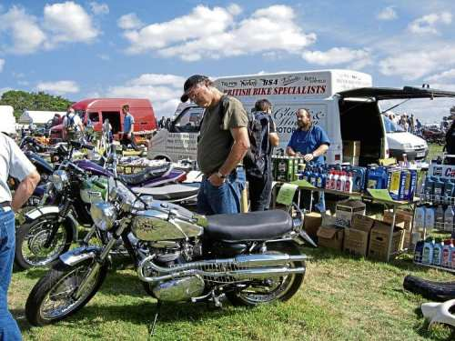 Netley Marsh Eurojumble visitors inspect some of the classic bikes for sale.