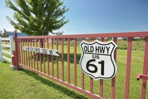 Old Hwy 61 Sign on Gate with New Orleans directional sign