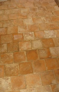 newly laid terracotta tile floor