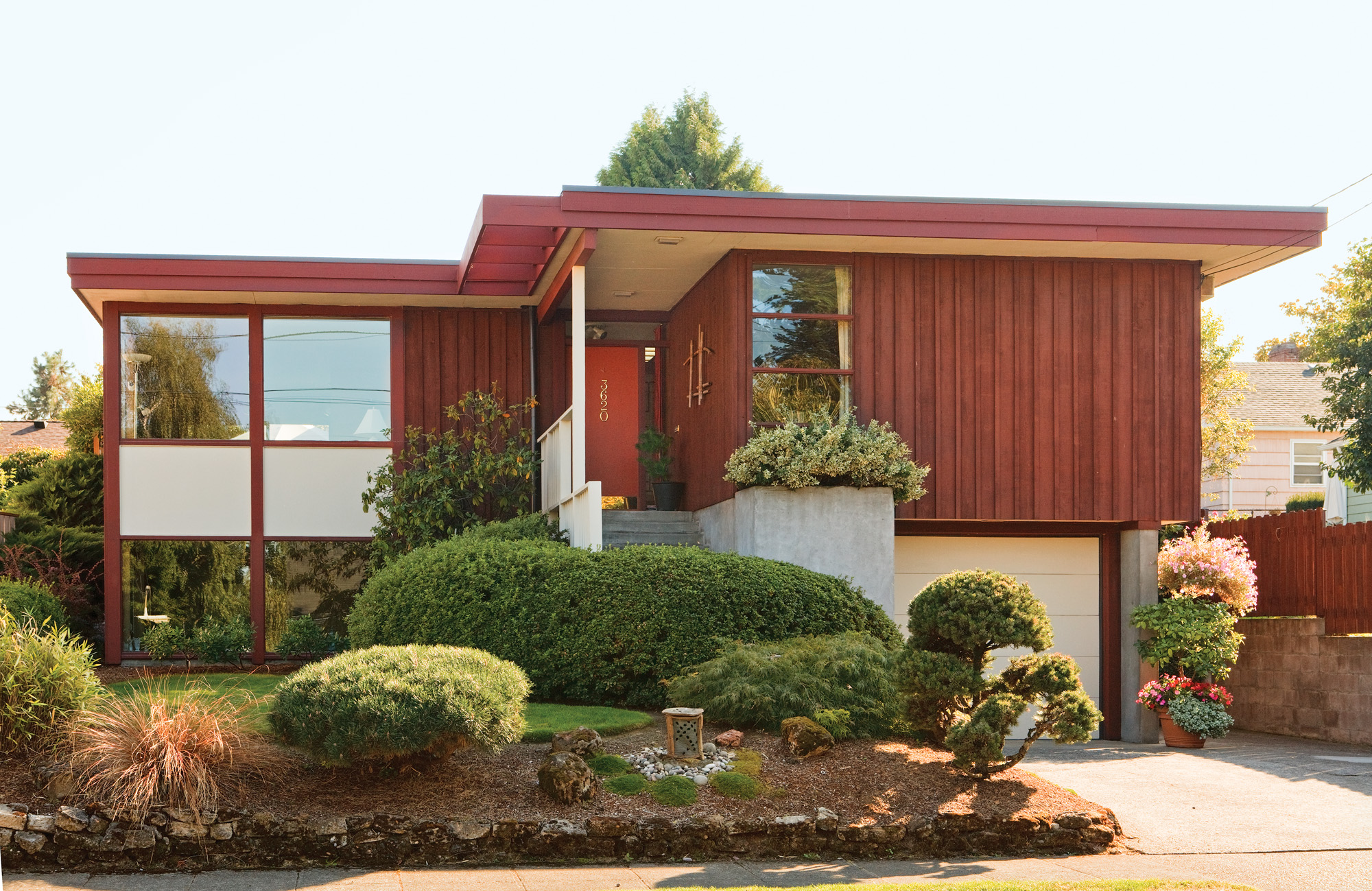 hight resolution of a 1955 usonian influenced house with cedar board and batten siding and a