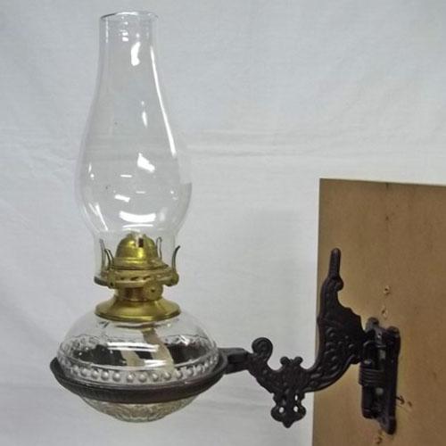 Kerosene lamp with wall bracket
