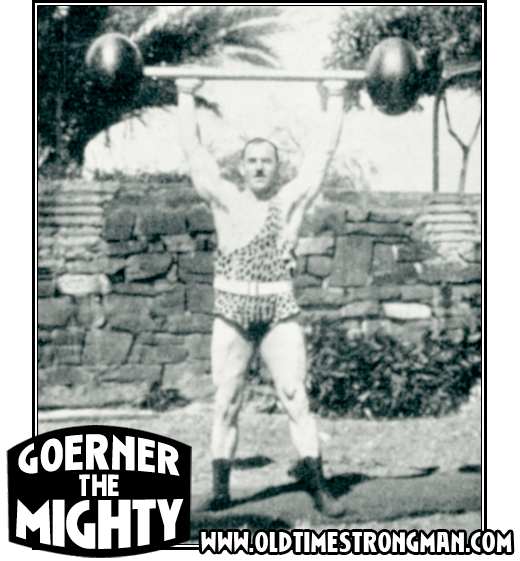 Hermann Goerner lifts a large globe barbell above his head