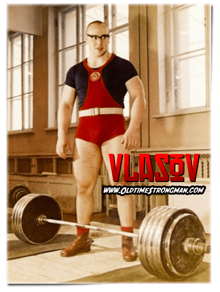 Soviet Weightlifting Champion Yuri Vlasov in his training hall with a Russian Olympic Set
