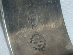 Hopi artist Hubert Yowytewa uses the same mark as Henry, but his is accompanied by a Sunface Hopi Guild stamp