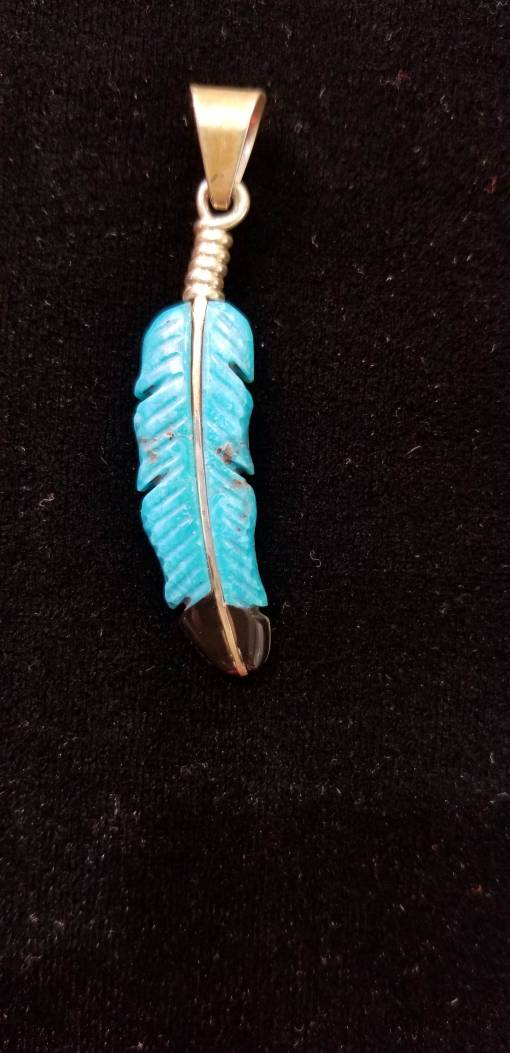 Navajo carved Spirit Feather pendant by Henry Yazzie