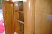 Classic 1955 Shasta Trailer showing original entryway cabinet