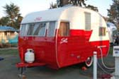 Very nicely restored red and white 1956 vintage shasta trailer