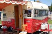 Restored 1960 vintage Shasta Airflyte trailer has a beautiful orange and white paint job