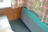 1962 Shasta 1500 trailer dining area, new bench seats and curtains