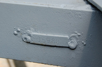 Photo of the welded-on VIN number plate installed by the factory on a vintage Shasta trailer frame