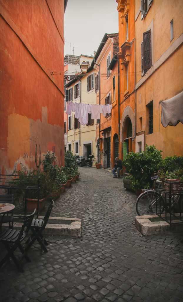 narrow winding cobblestone street in Italy.