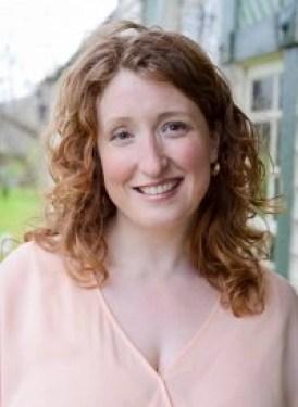 Headshot of redheaded blog author Kathleen.