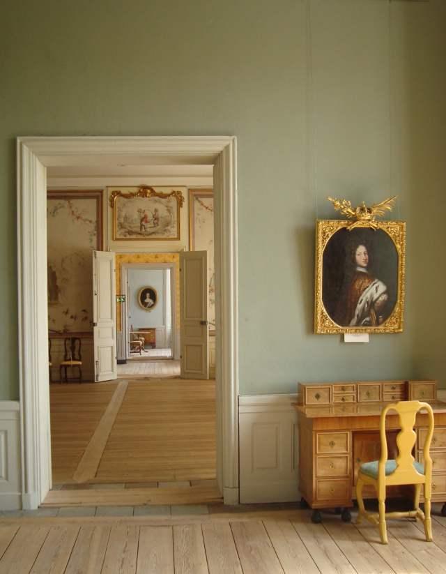 light green wall cream doors bare wood floors yellow chair