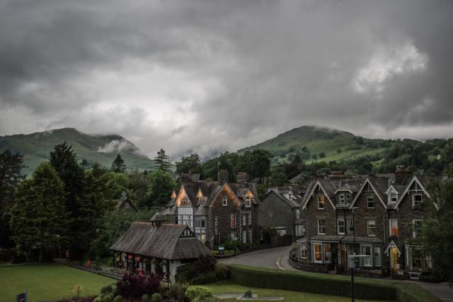 stone village, clouds, green peaks