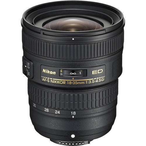 The lens has a minimum focal length of 18 mm with a 100° angle of view, making it ideal for capturing beautiful architectural compositions, detailed cityscapes, and vibrant travel photographs. With exceptionally high optical performance and Nikon's exclusive Silent Wave Motor for fast, precise, super-quiet autofocus operation, this affordable, carry-anywhere lens is a great option for advanced amateur photographers. FX-format compatible, wide-angle zoom lens with a focal-length range of 18-35mm and f/3.5-4.5 aperture. It's ideal for capturing sweeping landscapes, taking detailed shots of interiors, and shooting impromptu photographs on the street. Exceptionally high optical performance: optimized for use with high-pixel count Nikon digital SLR sensors. High resolution and superior contrast: the optical system incorporates three aspherical lenses and two ED (extra-low dispersion) glass elements for superior resolution and correction of unwanted aberrations and distortions. Nikon Super Integrated Coating: effectively reduces ghosting and flare even in backlit situations. SWM (Silent Wave Motor): for fast, precise, and super-quiet autofocus operation. Works with all Nikon DSLRs. Two focus modes: M/A (autofocus with manual override, manual priority) and M (manual focus). High-quality construction: featuring metal mount with rubber weather sealing. Compact, lightweight design: weighing just 385 g (13.6 oz), this is a lens you'll want to take with you everywhere. Lens hood and lens pouch: included.