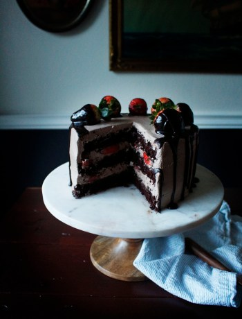 Chocolate Dipped Strawberry Cake. A romantic, dense and fluffy chocolate cake with a ganache meringue frosting.
