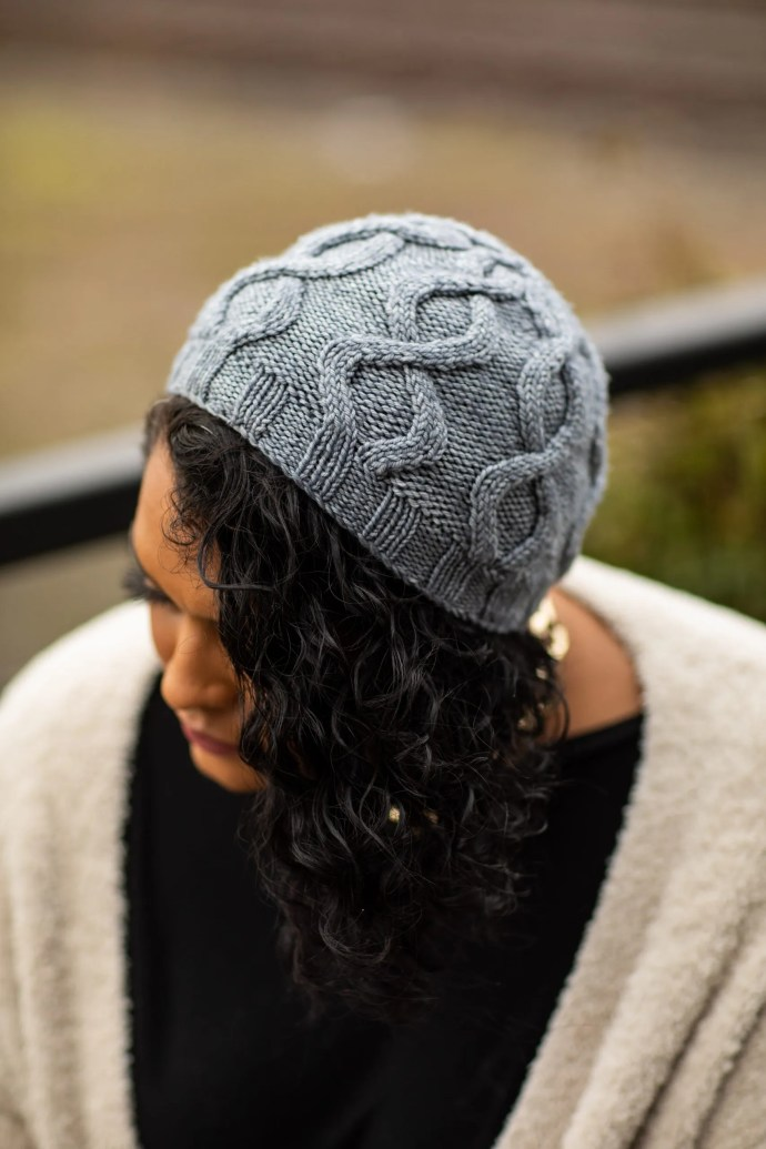 Woman of color wearing grey cable knit beanie