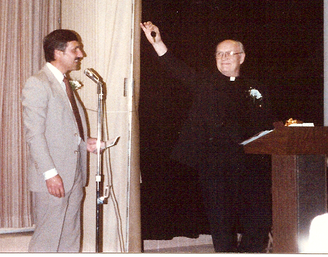 Fr. Kleefisch hands over the keys to Our Lady of Lourdes to Fr. Chuck Schramm at his retirement in 1986.