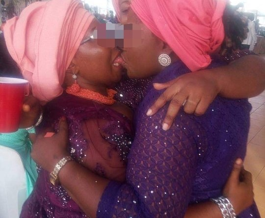 Two Matured Women Kissing Passionately Publicly Sparks Outrage (pic)