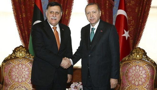 Αποδεικνύεται η προδοσία των Γερμανών! Απαίτησαν την παραμονή του τουρκόφιλου Σαράτζ στην Λιβύη!