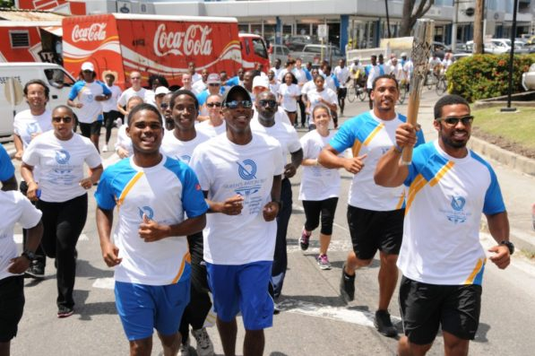 Local athletes carrying the baton