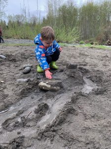 Child playing in the mud