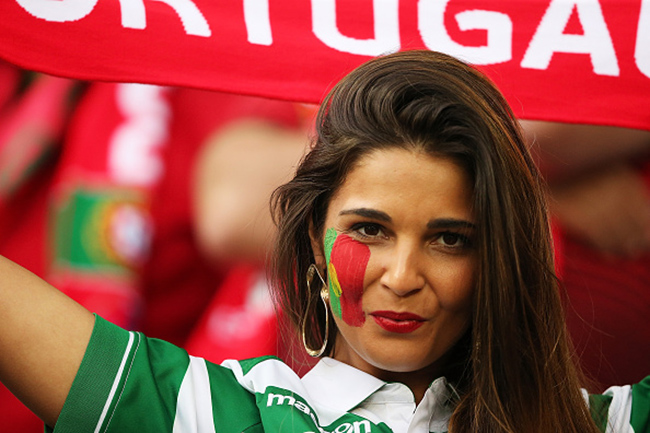 SAINT-ETIENNE, FRANCE - JUNE 14:  A Portugal fan shows her support prior to the UEFA EURO 2016 Group F match between Portugal and Iceland at Stade Geoffroy-Guichard on June 14, 2016 in Saint-Etienne, France.  (Photo by Matthew Ashton - AMA/Getty Images)