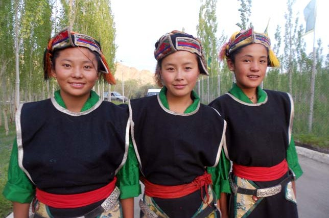 Tibetan girl in traditional dress for the birthday of HH